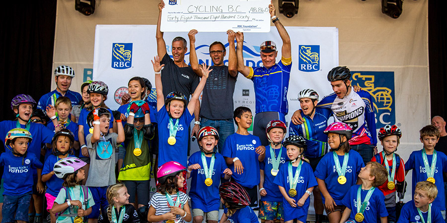 iRide kids on stage at RBC GranFondo Whistler receiving a huge cheque